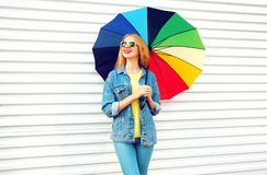 Fashion happy smiling woman with colorful umbrella, dreams on white. Background royalty free stock images