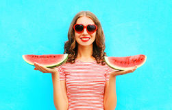 Fashion happy smiling young woman is holding slice of watermelon Royalty Free Stock Photo
