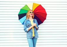 Fashion happy woman laughing with colorful umbrella, dreams on white. Background stock photography