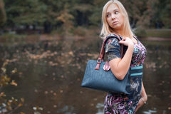 Fashion  happy woman  near the river Stock Photography