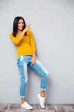 Fashion happy woman showing finger right Stock Image