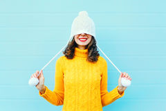 Fashion happy young woman in knitted hat and sweater having fun over colorful blue Royalty Free Stock Photos