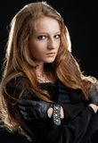 Fashion hard-rock girl in black cloak Stock Image