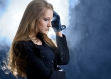 Fashion hard-rock girl in black cloak Stock Photos