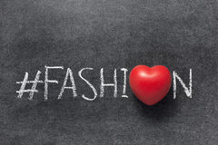 Fashion hashtag. Handwritten on chalkboard with red heart used instead of O Stock Photos