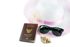 Fashion hats pink and sunglasses with conch and passport t Stock Images