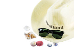 Fashion hats and sunglasses with conch on white background Stock Photo