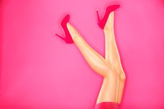Fashion high heels and sexy legs. Woman fashion pink high heels and sexy legs. Hot pink high heels shoes and sexy female legs on pink background Royalty Free Stock Photos