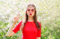 Fashion hippie woman having fun in flowering garden. Fashion beautiful hippie woman having fun in flowering garden royalty free stock photography