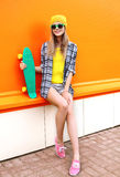 Fashion hipster cool girl in sunglasses and colorful clothes Stock Photography