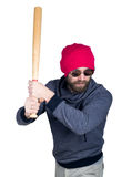 Fashion hipster cool man in sunglasses and colorful clothes brandishing a baseball bat Stock Photo