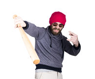 Fashion hipster cool man in sunglasses and colorful clothes brandishing a baseball bat Royalty Free Stock Photography