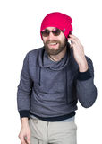 Fashion hipster cool man in sunglasses and colorful clothes talking on the phone. isolated on white background Stock Photo