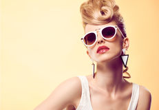 Fashion Hipster girl, Stylish hairstyle. Makeup Royalty Free Stock Photos