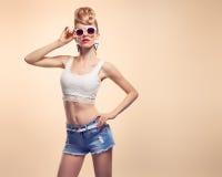 Fashion Hipster girl, Stylish hairstyle. Makeup Stock Photo