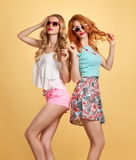 Fashion hipster girl in stylish summer outfit, fun Royalty Free Stock Image