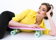 Fashion hipster girl in yellow shirt in sunglasses Stock Images
