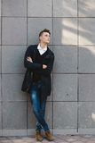 Fashion hipster male model posing outdoor royalty free stock photos
