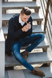 Fashion hipster male model smoking Stock Image