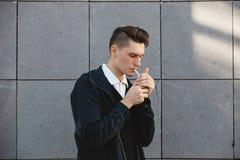 Fashion hipster male model smoking Stock Image