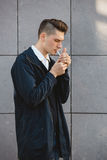 Fashion hipster male model smoking Stock Images