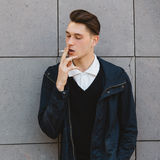 Fashion hipster male model smoking Royalty Free Stock Photography