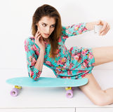 Fashion hipster model in colorful dress making Stock Photos