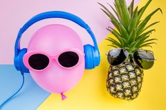 Fashion Hipster Pineapple and pink air balloon on colorful backg Stock Image