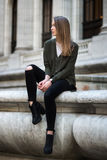 Fashion hipster portrait of young elegant woman outdoor in sweater and jeans Stock Photo