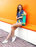 Fashion hipster pretty cool girl with skateboard having fun Stock Image
