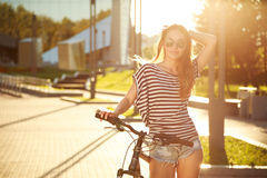 Fashion Hipster Teenager with Bicycle in the City Stock Image