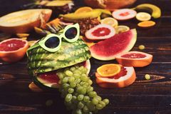 Fashion hipster watermelon fruit. Bright summer color, accessories. Tropical watermelon with sunglasses. Creative art. Concept. Summer party background stock photography