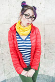Fashion hipster woman with colorful hair having fun. Over wall background Stock Images