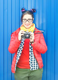 Fashion hipster woman with colorful hair with retro camera Stock Photos