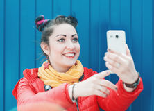 Fashion hipster woman with colorful hair taking selfie Royalty Free Stock Photography