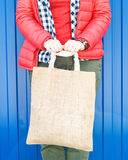 Fashion hipster woman holding empty canvas bag. Template mock up Stock Photography