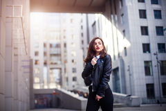 Fashion hipster woman posing outdoor. leather jacket,brunette hair, bright red lips, sunglasses.Street fashion concept. Royalty Free Stock Image