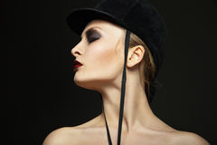 Fashion horsewoman wearing black hat Stock Images