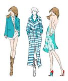 Fashion illustration. Stylish fashion models. Fashion girls set. Sketch. Girls in a dress, coat and suit Royalty Free Stock Image