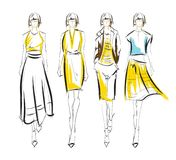 Stylish fashion models. Fashion girls set. Fashion illustration. Stylish fashion models. Fashion girls set. Sketch. Girls in a dress and suit Stock Photography