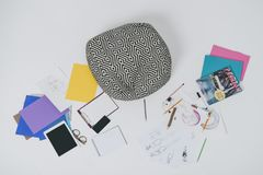 Fashion illustrations and digital devises on floor. With cushion stock image