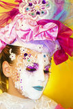 Venetian mask. Fashion the image of the Venetian masks on a womans face royalty free stock photography