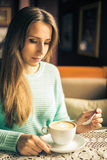 Fashion image of woman holding white cup of morning cappuccino Stock Photography