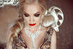 Fashion indoor portrait of beautiful sensual blond woman with ma Royalty Free Stock Images