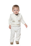 Fashion infant boy. An infant boy is standing on the white background Royalty Free Stock Image