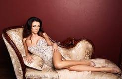 woman with dark hair in luxurious dress posing in elegant b royalty free stock photo