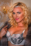 Fashion interior photo of gorgeous woman wears luxurious lingerie and fur coat. Stock Image
