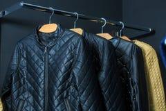 Fashion jacket on hangers Stock Photos