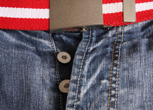 Fashion jeans. With striped red and white belt Royalty Free Stock Photography