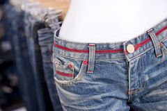 Fashion jeans for women in shop Royalty Free Stock Images